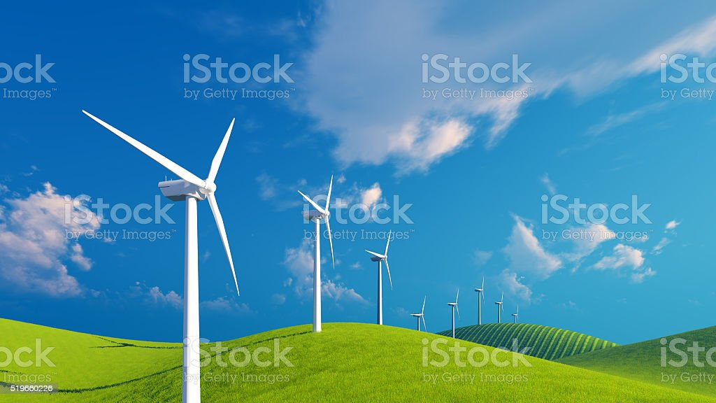 Row of wind turbines on green fields stock photo