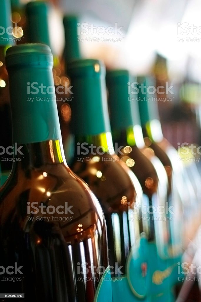 Row of Wine Bottles - Shallow Focus royalty-free stock photo