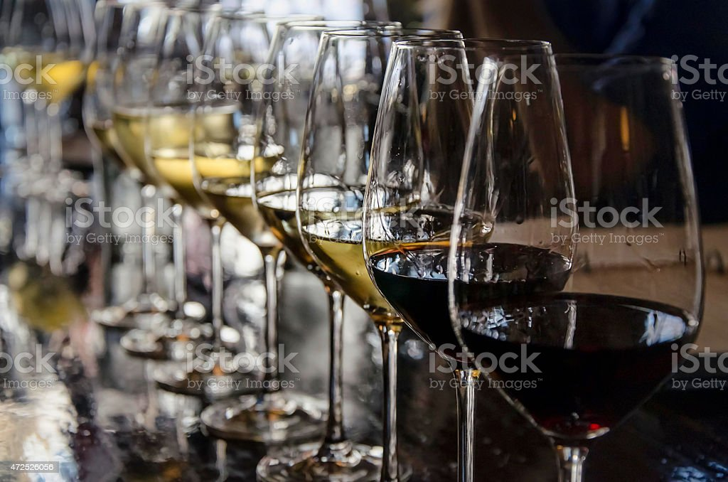 row of wine glasses stock photo