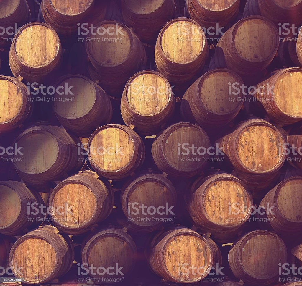 Row of wooden barrels of tawny portwine in cellar stock photo
