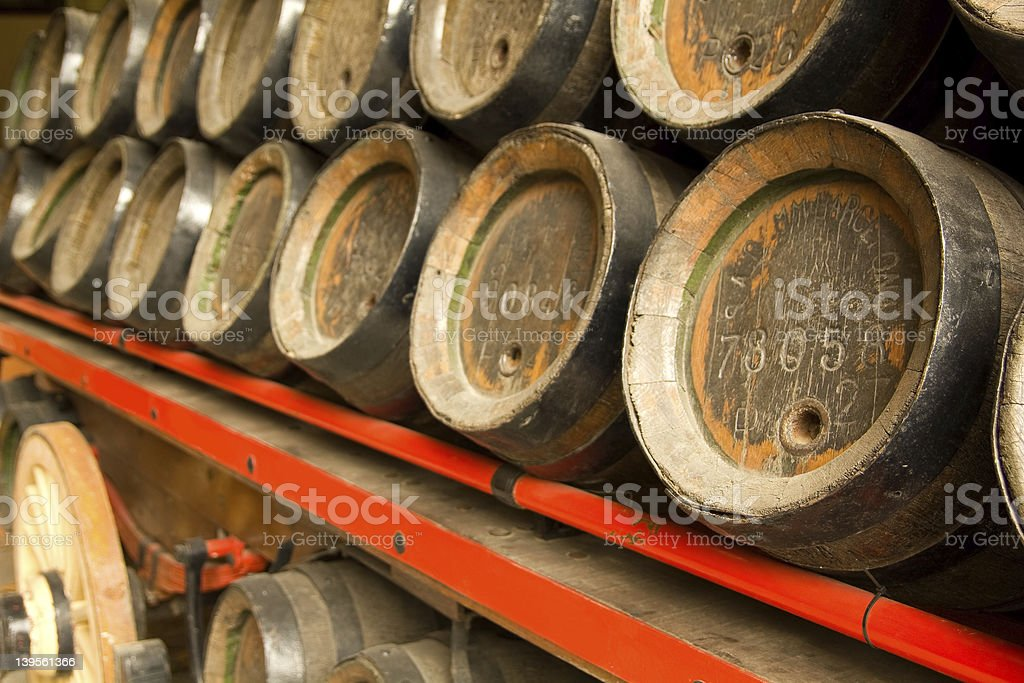 Row of wooden beer barrels royalty-free stock photo