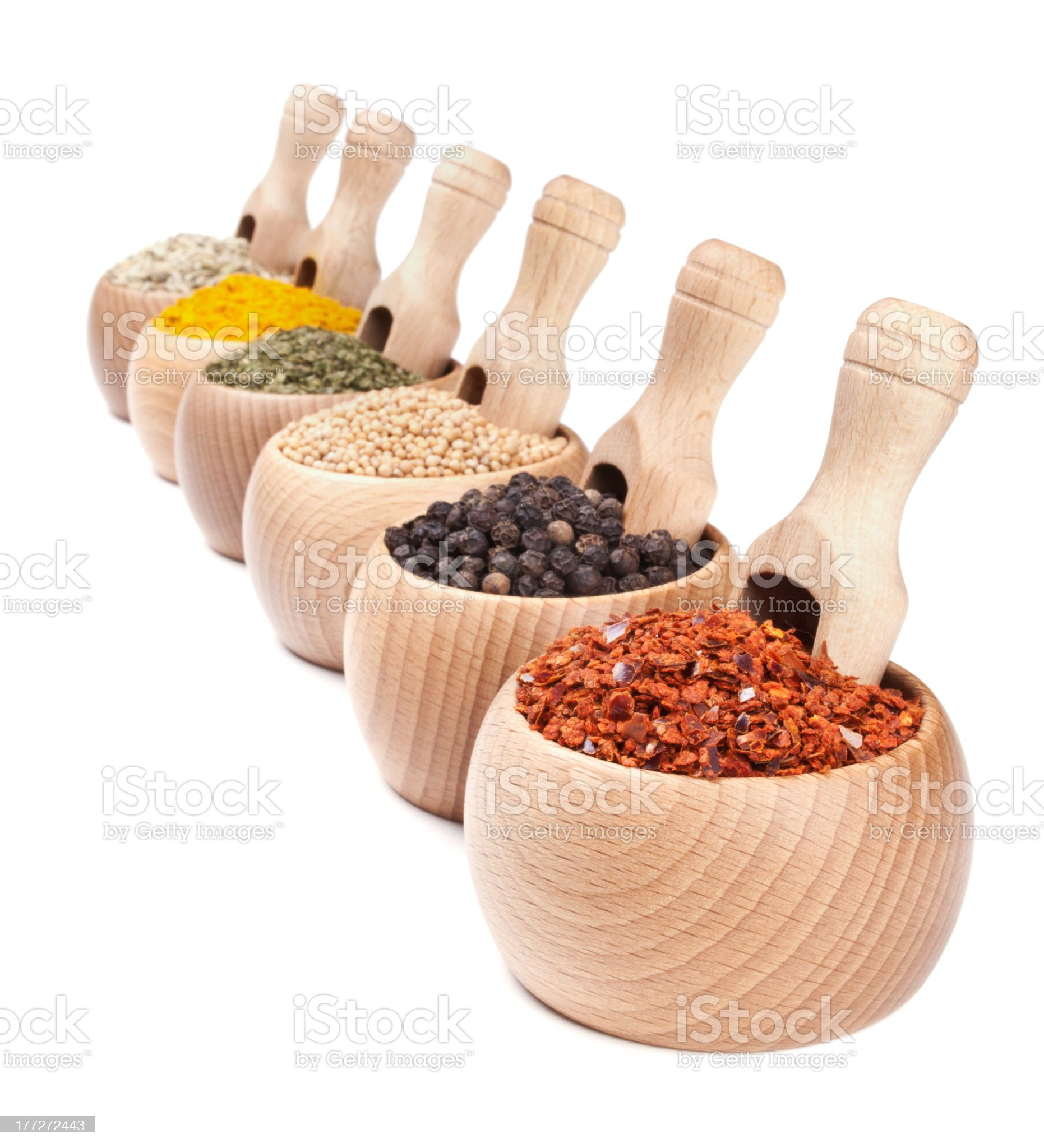 Row of wooden bowls with spices in them royalty-free stock photo
