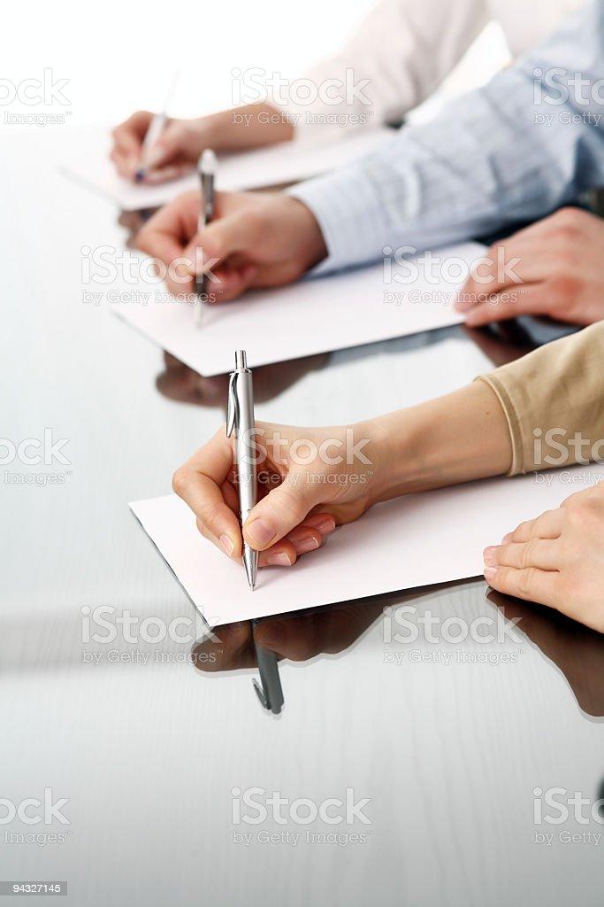 Row of writing human hands stock photo