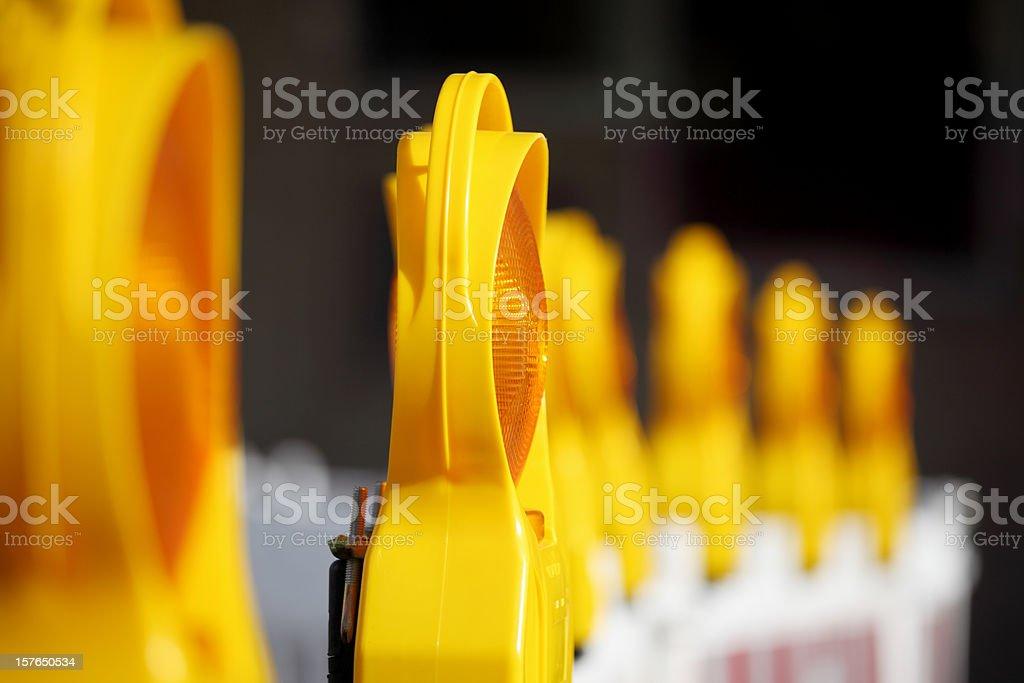 row of yellow and orange traffic  warning lamps stock photo