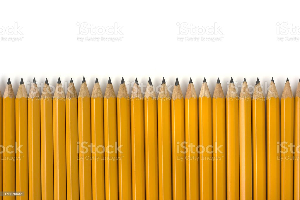 Row of Yellow Pencils Repetition for Education on White Background stock photo
