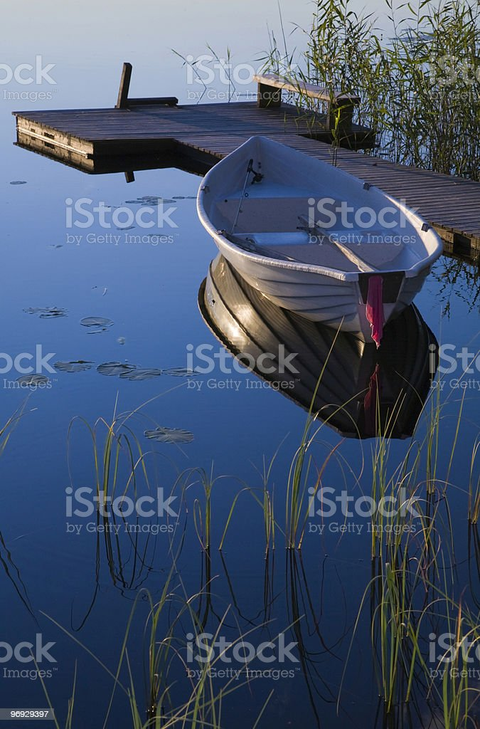 Rowboat and Dock royalty-free stock photo
