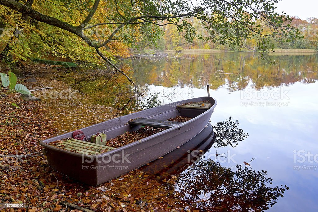 Rowboat and Lake in Autumn stock photo