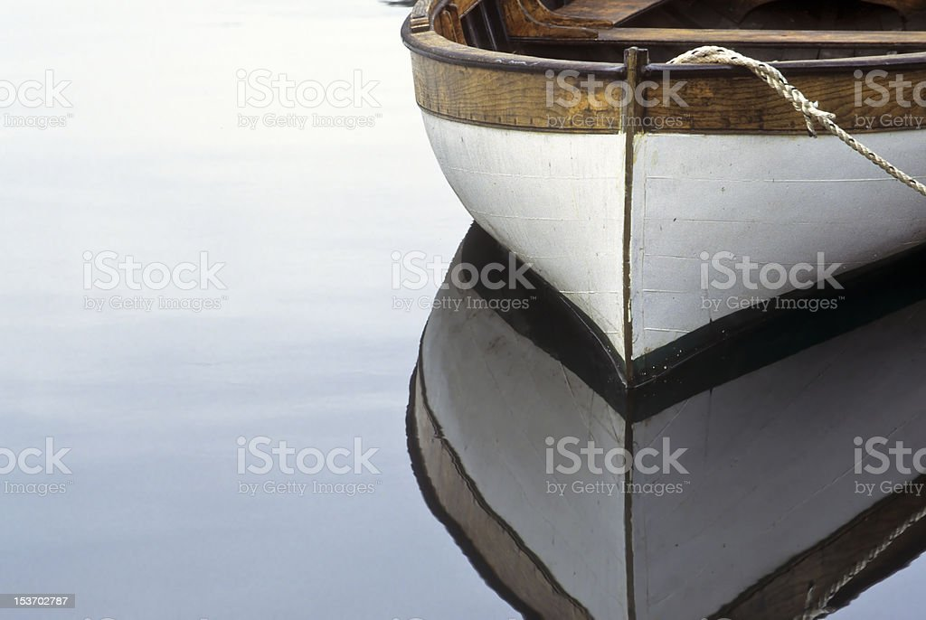 Rowboat and reflection in water stock photo