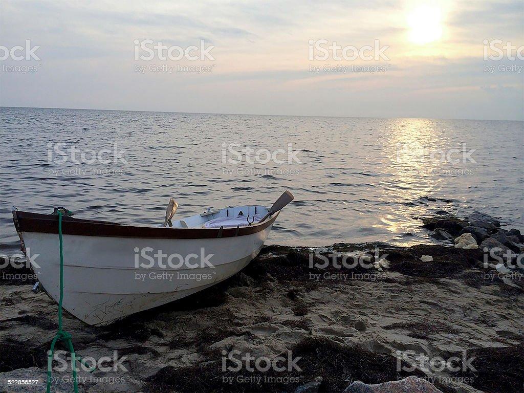 Rowboat Docked in Sand stock photo