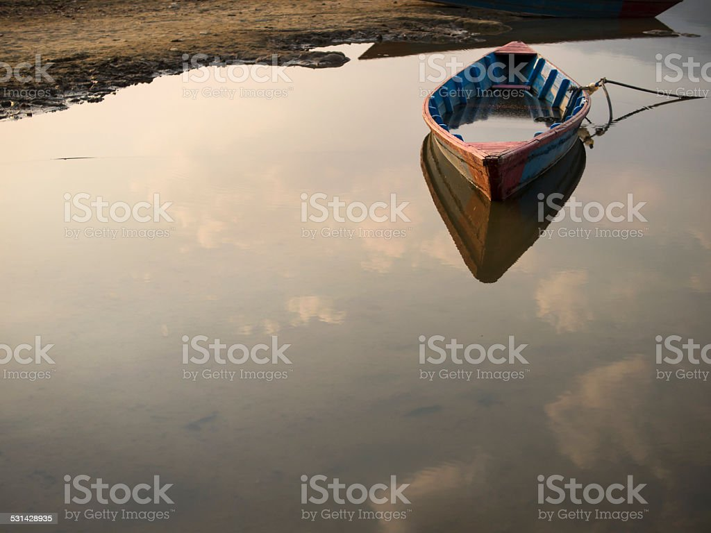 Rowboat Floating on Still Waters of a Lake stock photo