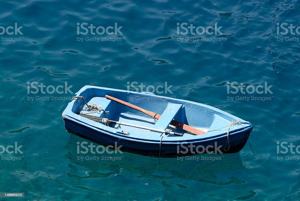 Rowboat in blue water royalty-free stock photo