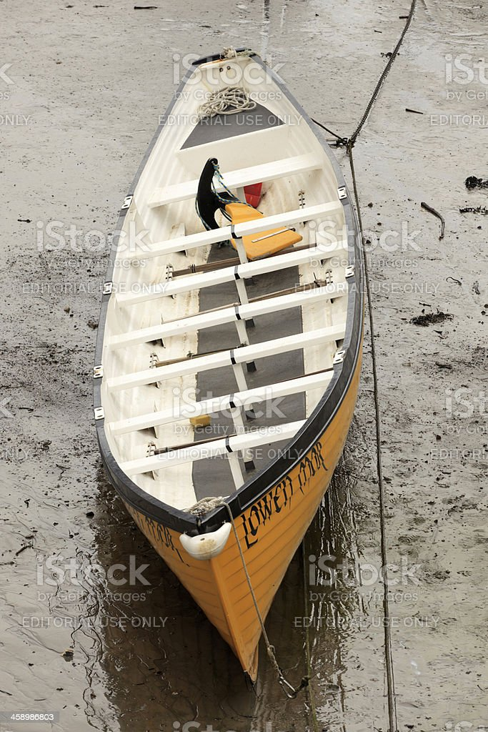 rowboat in the harbour of Porthleven at low tide royalty-free stock photo