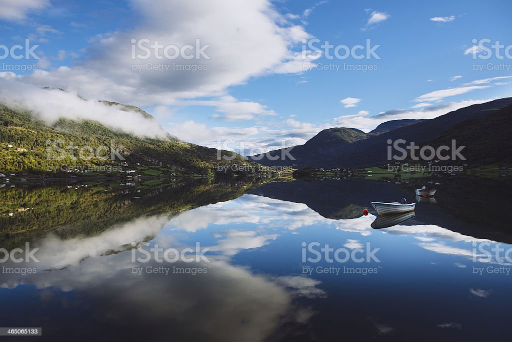 Rowboat on a Glassy Fjord - Western Norway Fjords stock photo