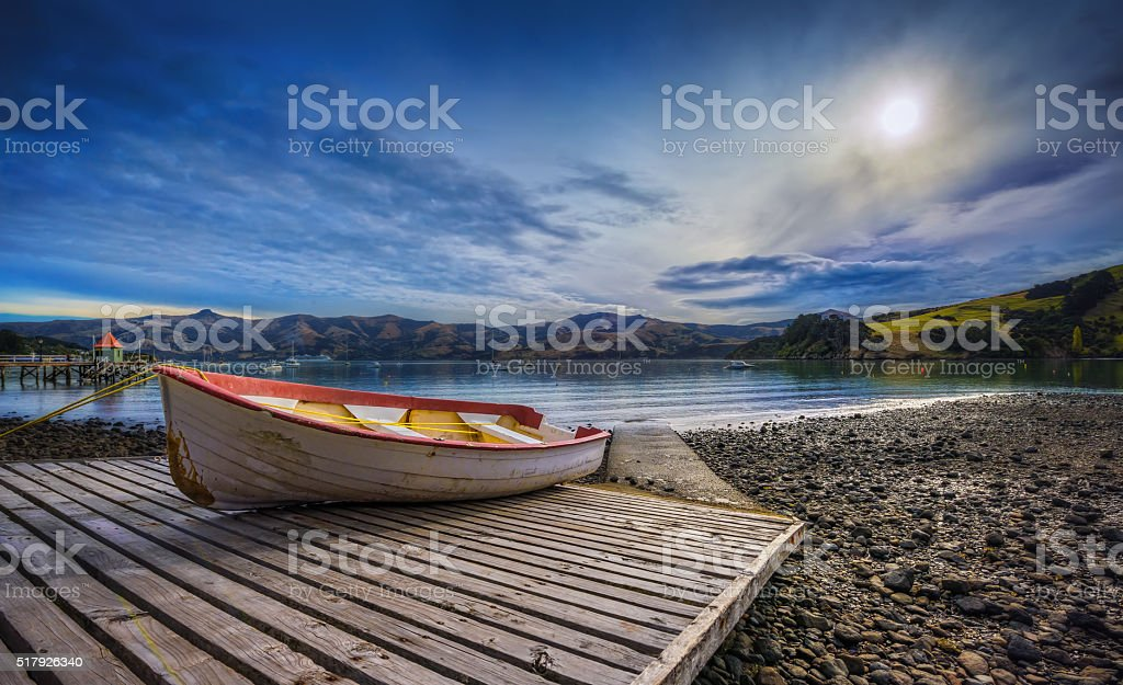 Rowboat On A Slip During Low Tide In Akaroa Harbour stock photo