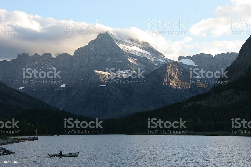 Rowboat on lake, Towering Mountain royalty-free stock photo