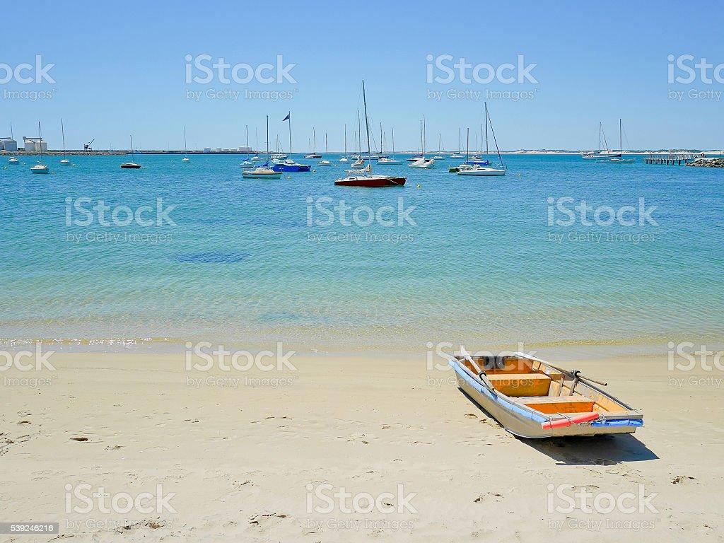 Rowboat on the beach stock photo