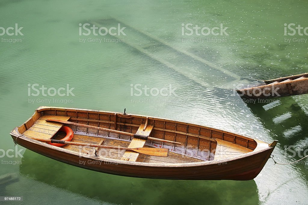 Rowboat on the Lake by a Ladder royalty-free stock photo