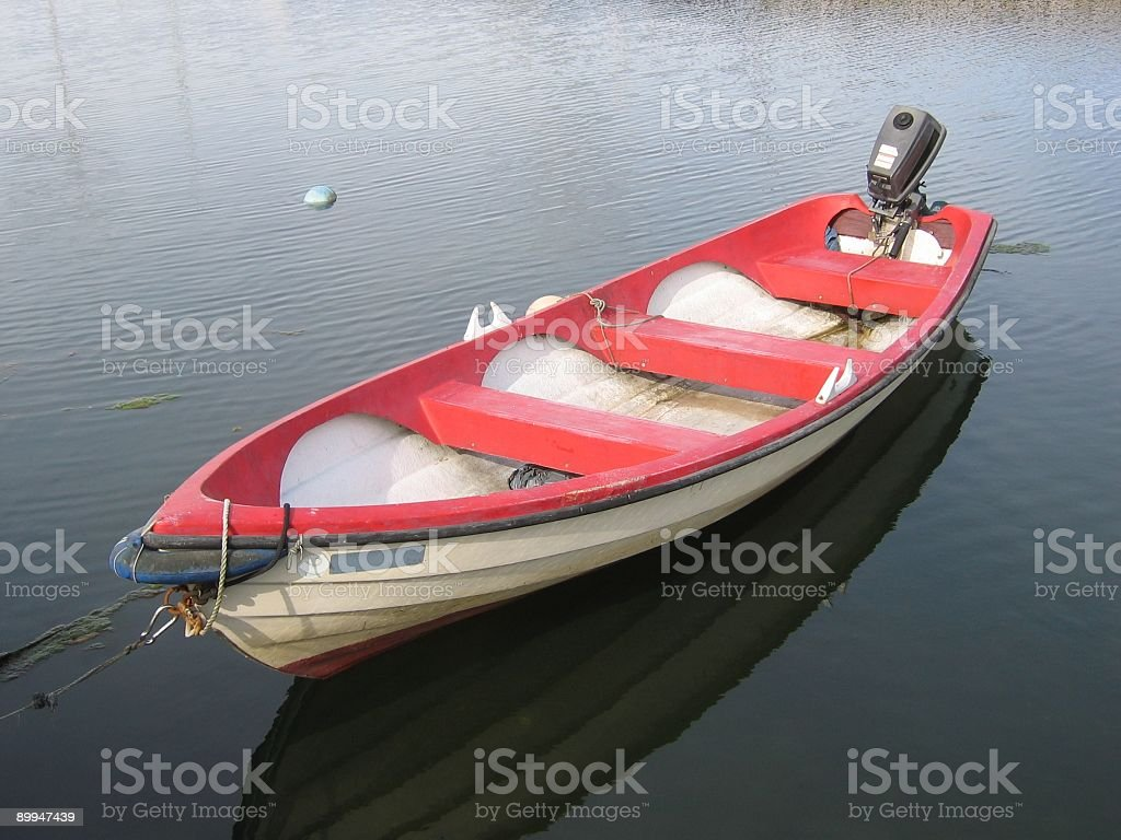 rowboat with motor royalty-free stock photo