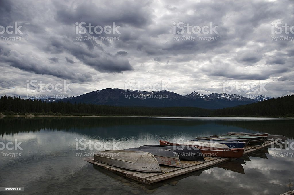 Rowboats at a lake in stormy weather royalty-free stock photo