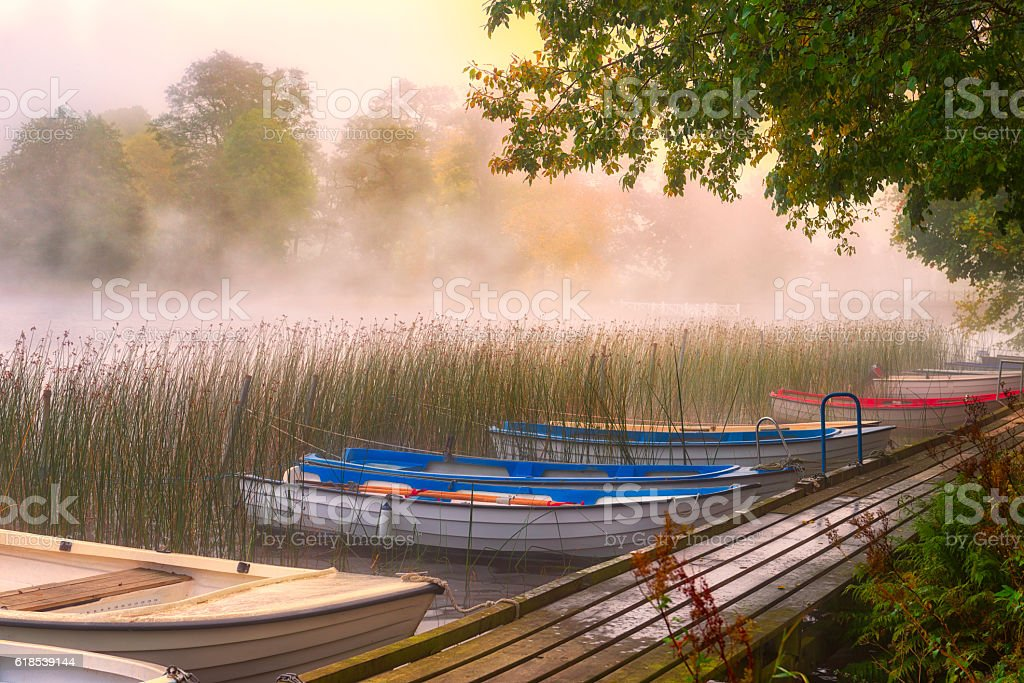 Rowboats moored at a wooden jetty stock photo