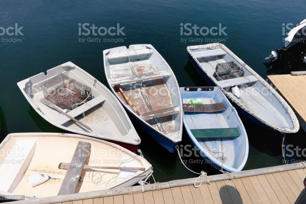 Rowboats tired up in Rockport, MA harbor stock photo