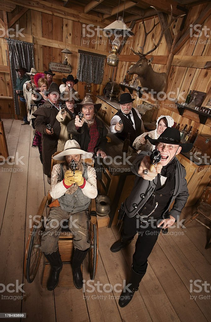 Rowdy Crowd with Guns in Saloon stock photo