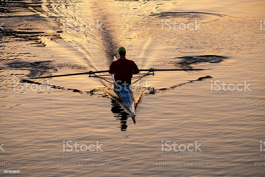 Rower in kayak (single scull) in late afternoon light stock photo