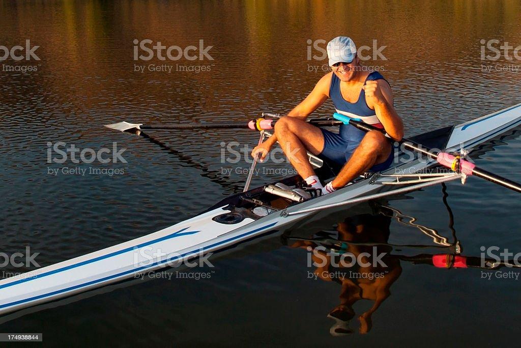 Rower man is happy to score stock photo