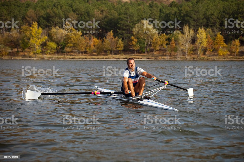 Rower man make a mistake about balance stock photo