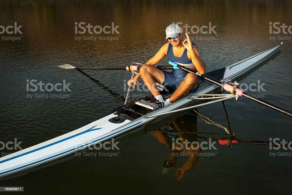 Rower man on boat Everythink is okay royalty-free stock photo