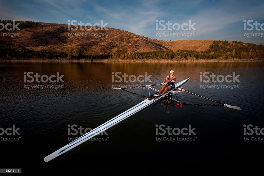 Rower man on boat shot with wide angle stock photo