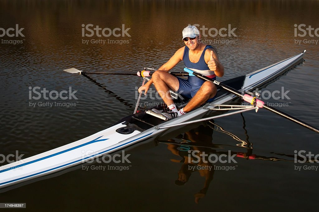 Rower man on sculland doing hand sign stock photo