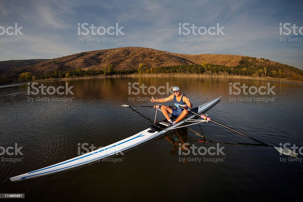 Rower man on sculling doing hand sign stock photo