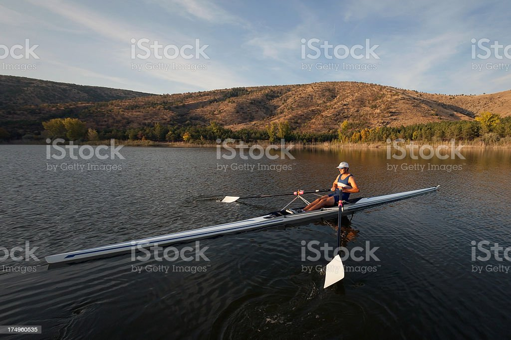 Rower man sculling on lake stock photo