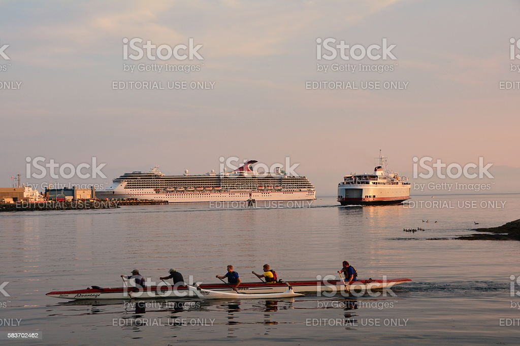 Rowers Ferry and a cruise ship stock photo
