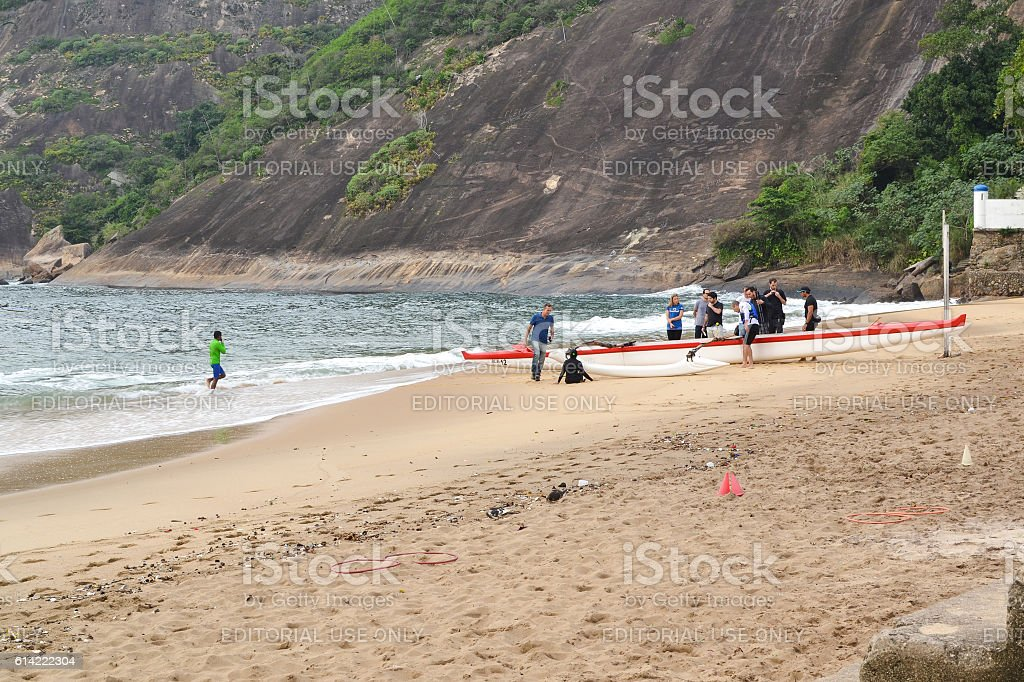 Rowers ready to set up sail stock photo