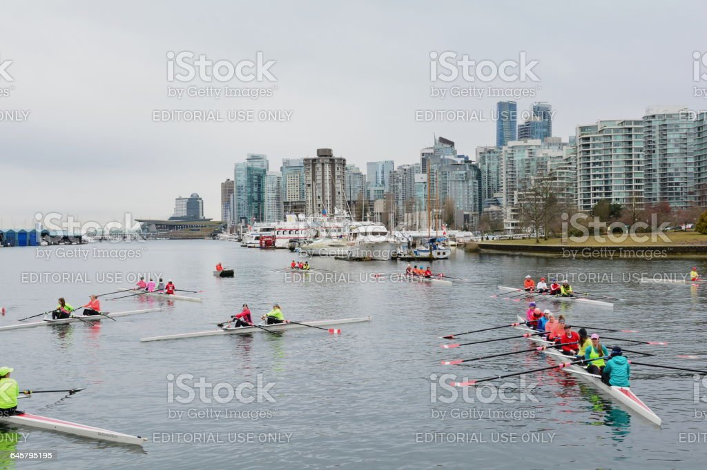 Rowers rowing and the skyline of Vancouver BC,Canada stock photo