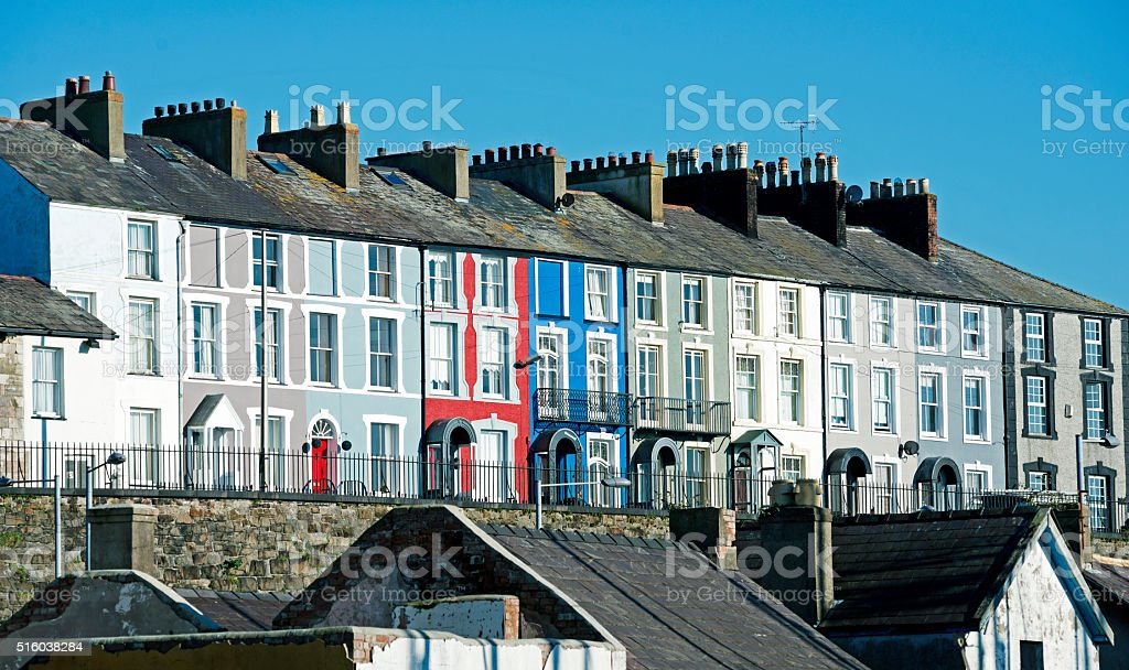 Rowhouses above quay on river in Caernarvon Wales stock photo