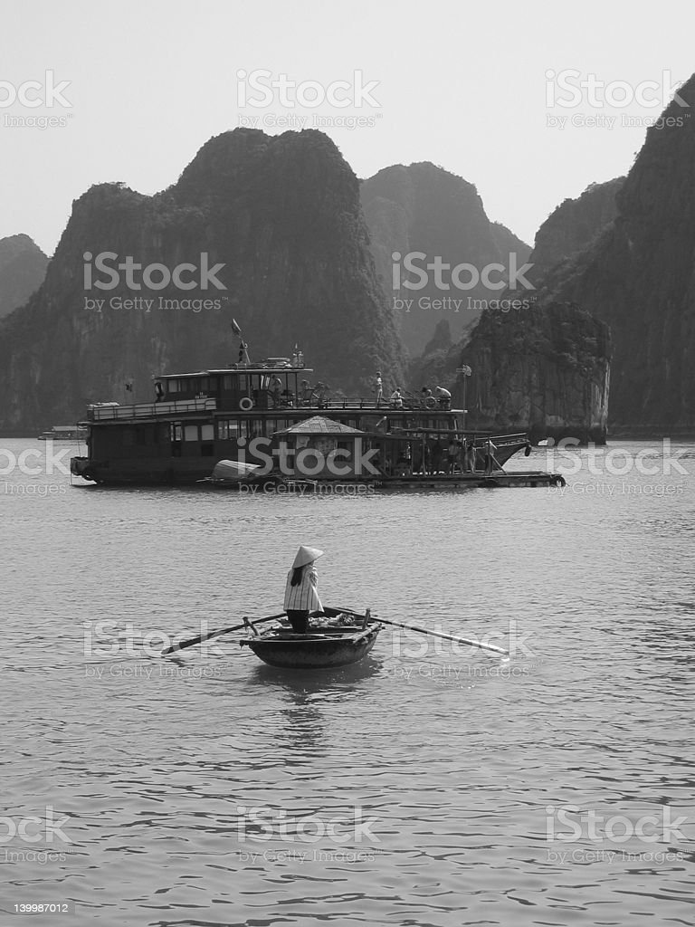 Rowing across Halong Bay royalty-free stock photo