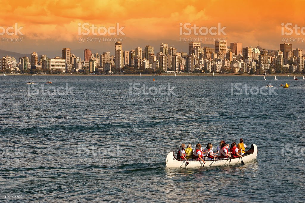 Rowing along a skyline at sunset stock photo