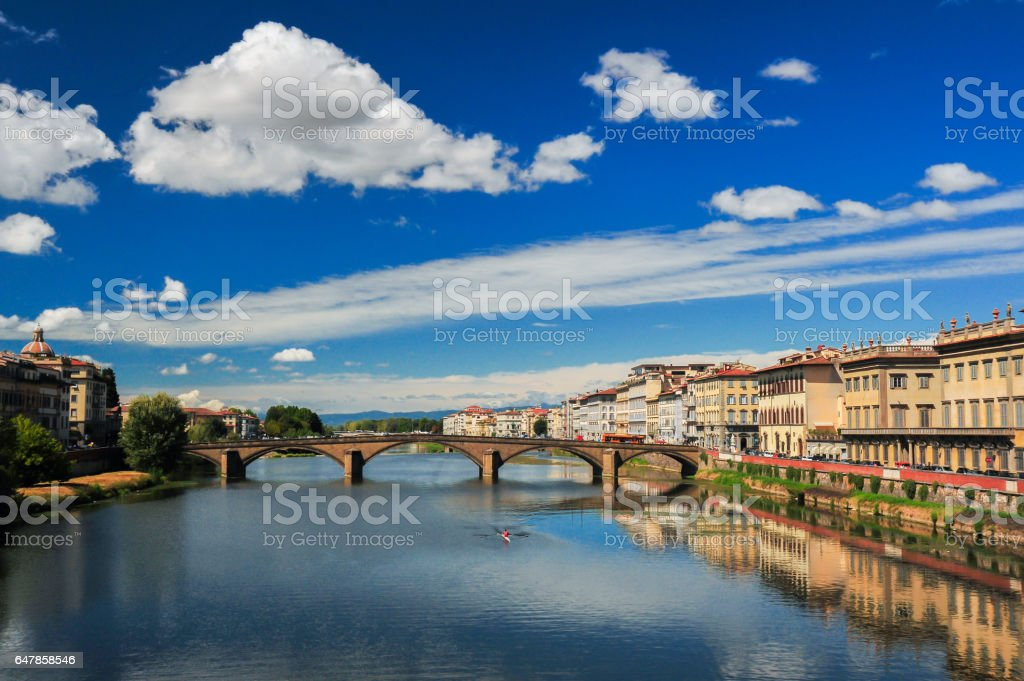 Rowing along the Arno River, Florence, Italy stock photo