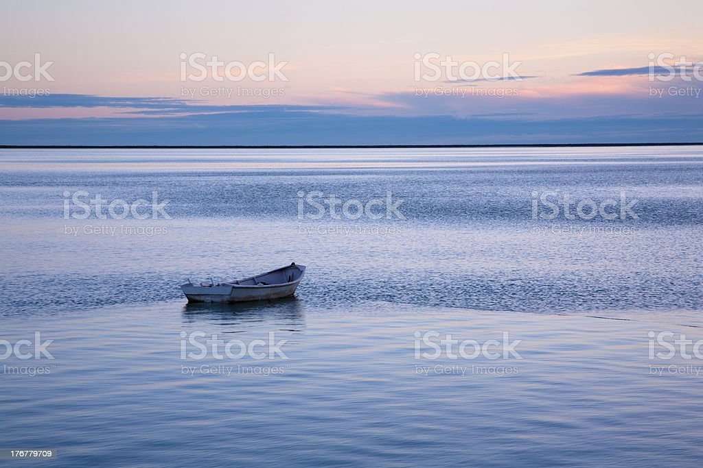 Rowing Boat Abandoned on Calm Water royalty-free stock photo