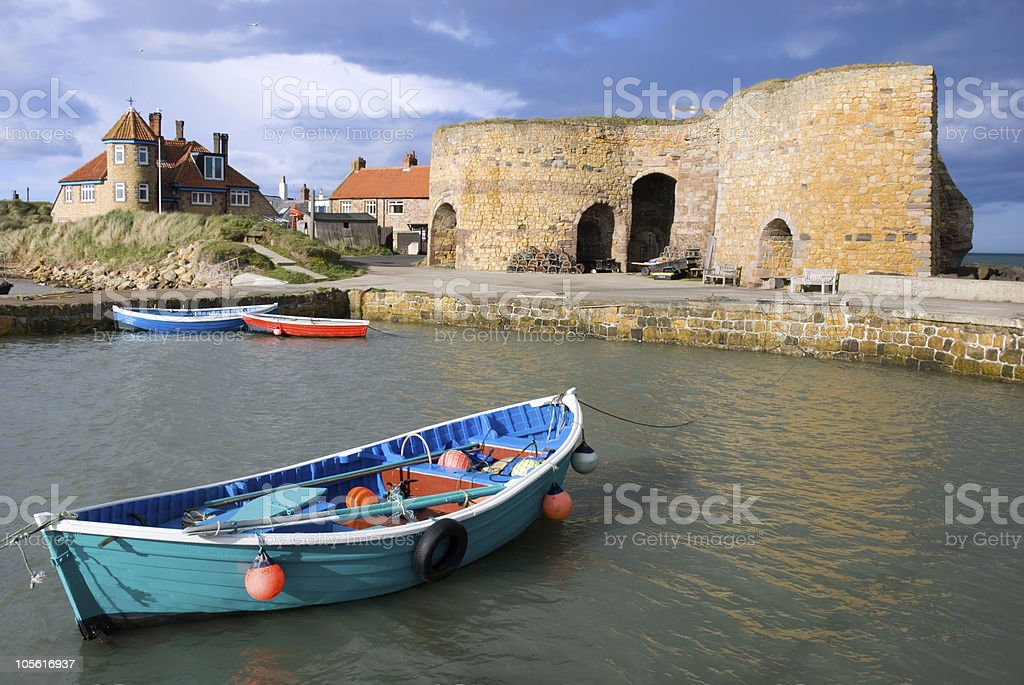 Rowing boat and lime kilns stock photo