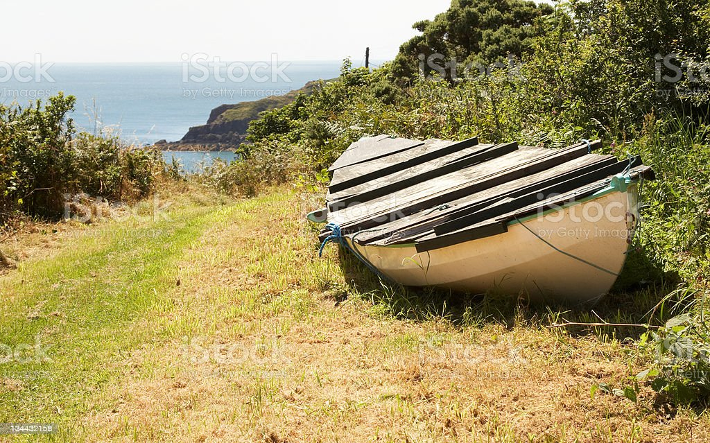 Rowing boat on edge of headland path royalty-free stock photo