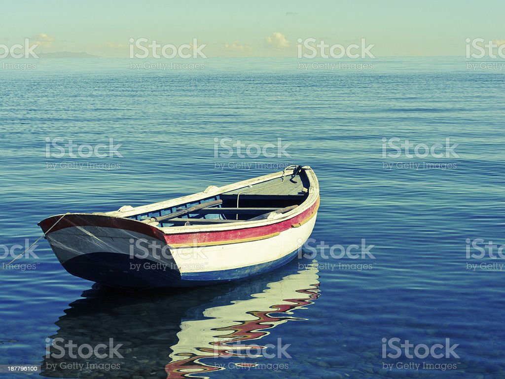 rowing boat on lake titicaca stock photo