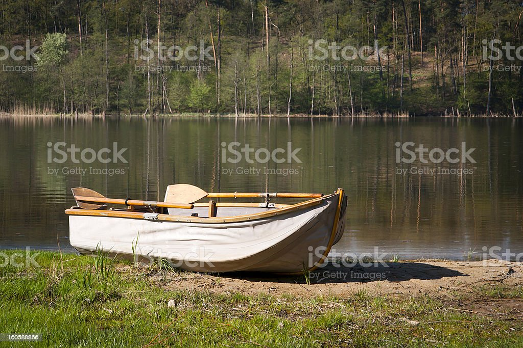 Rowing boat on the lake shore royalty-free stock photo