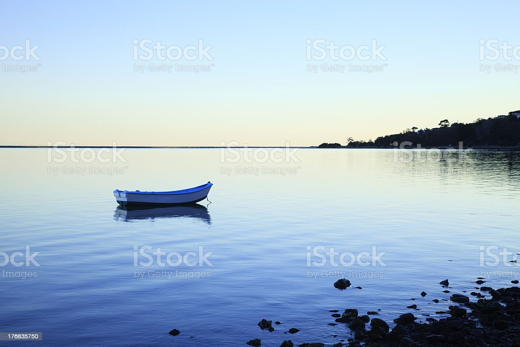 Rowing Boat on Tranquil Lake royalty-free stock photo