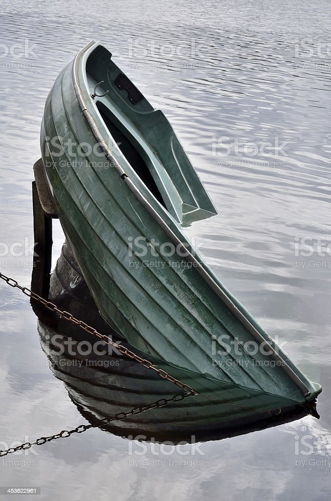 Rowing boat sinking stock photo
