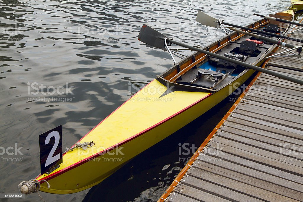 Rowing boat tied to the pier royalty-free stock photo