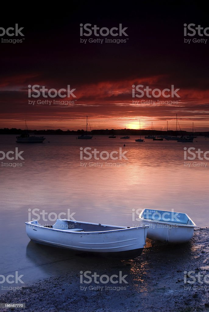 Rowing boats in the sunrise, River Deben, Walderingfield, Suffolk stock photo